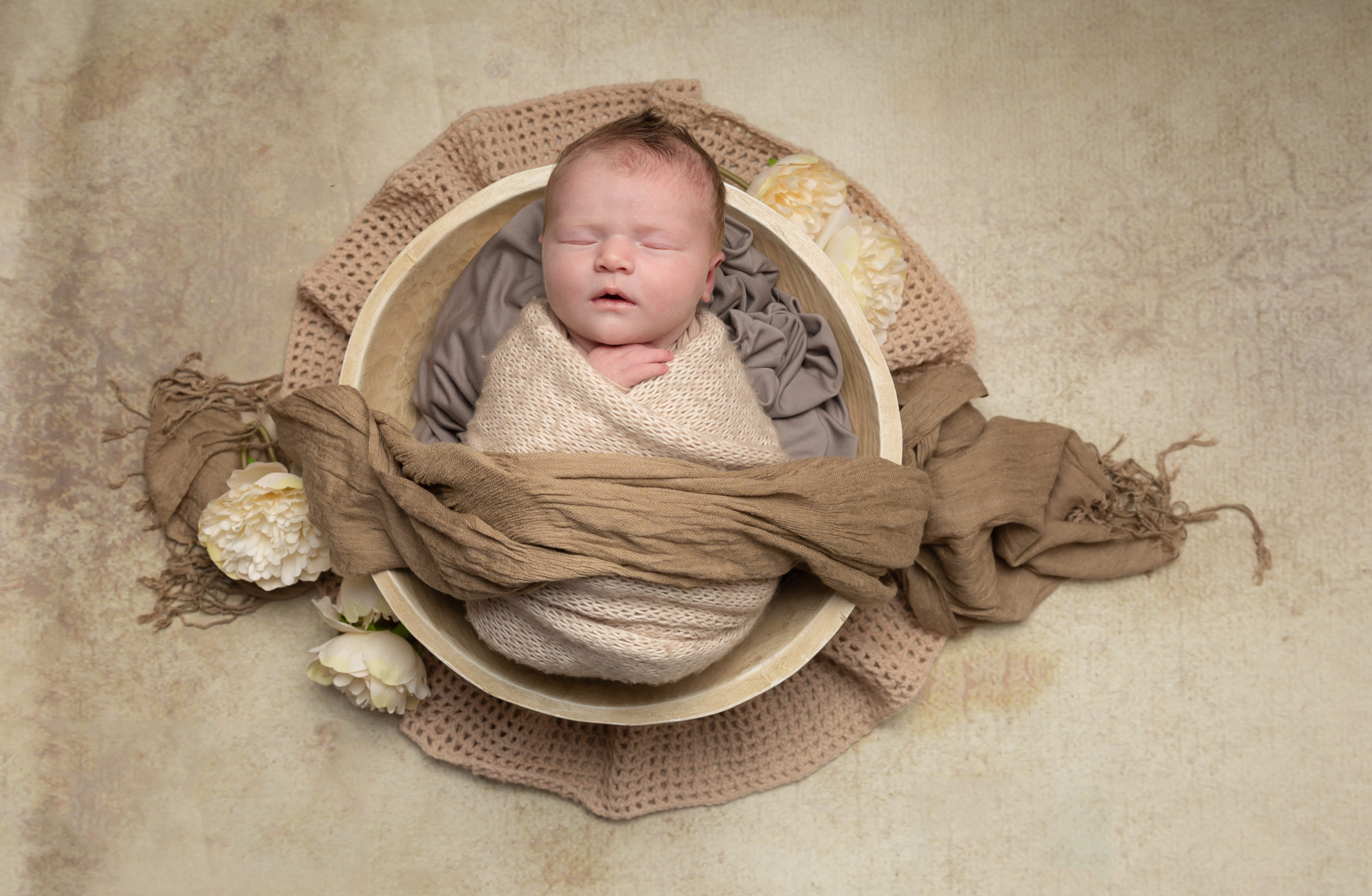 Baby in Cream wrap in cream wooden bowl