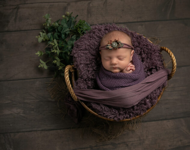 Baby wrapped in purple
